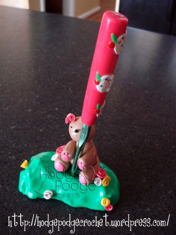 My first EVER polymer clay creation (which I adore!!) This teddy bear crochet hook holder is an original creation <3