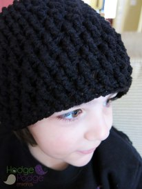 Child hat made with an H crochet hook and medium worsted weight yarn.